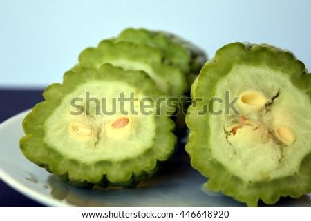 Bitter melon or bitter gourd on plate - stock photo