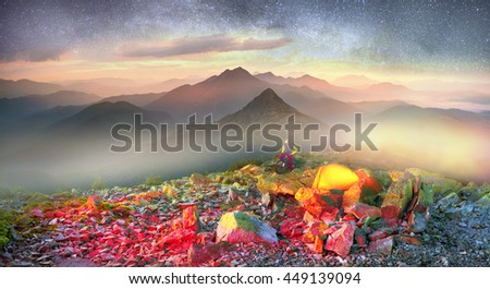 Bivouac extreme riders MTB marathon on the Carpathian Gorgan through peaks and Synyak Hamster on a background of the night with beautiful valley of the Blue Ridge Mountains - stock photo