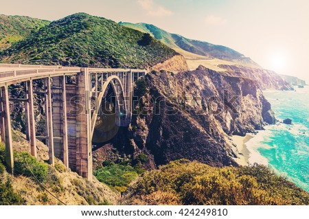 Bixby Creek Bridge on Highway #1 at the US West Coast traveling south to Los Angeles, Big Sur Area, California - Picture in a dreamy look with cross processed color look - stock photo