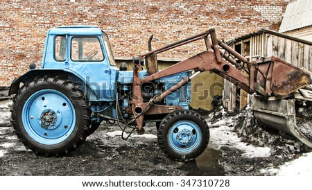 BIYSK, RUSSIA - MAY 29:Old excavator on the background of a brick wall, 29 may 2010 on Biysk, Russia. - stock photo
