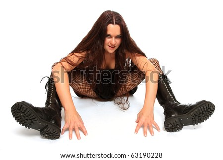Bizarre goth woman with big boots on white background.