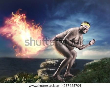 Bizarre naked man farts flame - stock photo