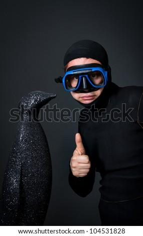 bizarre successful diver catching a penguin - stock photo