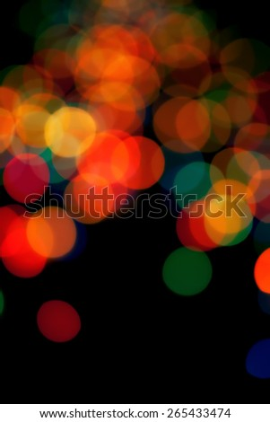 Black abstract background with colorful blurred lights - stock photo