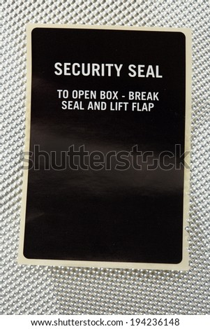 Black adhesive security seal to ensure human body parts transportation - stock photo