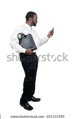 Black African American business man using a cell phone for texting - stock photo