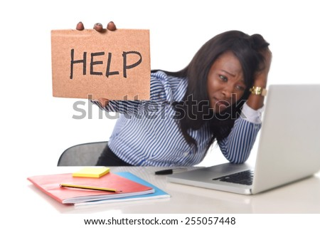 black African American ethnicity tired and frustrated woman working as secretary in stress at work office desk with computer laptop asking for help in business frustration concept - stock photo