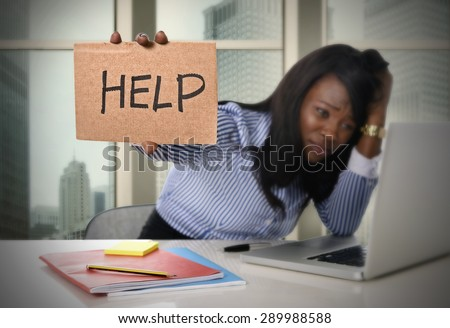 black African American ethnicity tired and frustrated woman working as secretary in stress at work business district office desk with computer laptop asking for help in frustration concept - stock photo