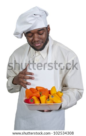 Black African American male chef holding a bowl of fresh sweet peppers - stock photo