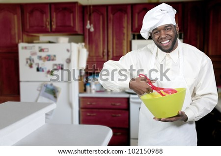 Black African American male chef showing his approval of the taste of food - stock photo
