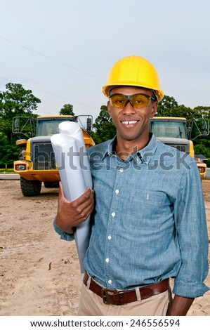 Black African American male construction worker a job site. - stock photo