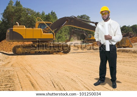 Black African American male construction worker a job site with a backhoe - stock photo