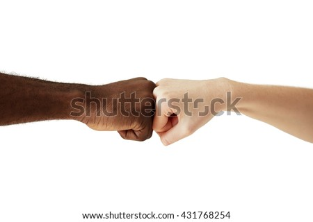 Black African American man touching knuckles with white Caucasian woman in agreement, partnership and cooperation. Two people of different cultures and races greeting each other in modern handshake - stock photo