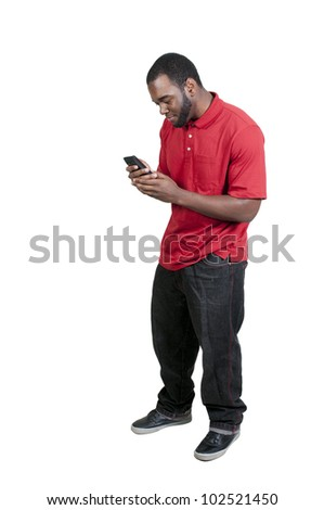 Black African American man using a cell phone for texting - stock photo