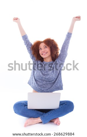 Black African American student girl using a laptop, ocer white background - stock photo
