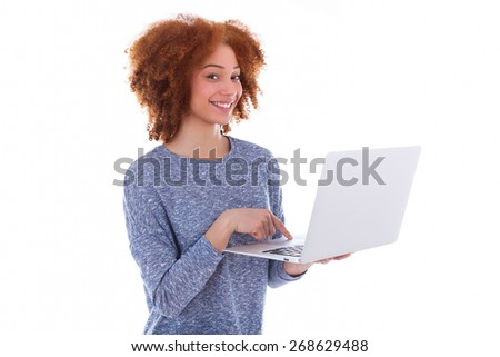 Black African American student girl using a laptop, over white background