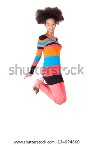 Black African American teenage girl with a afro haircut jumping of joy, isolated on white background - stock photo
