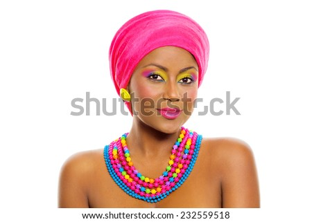 Black african beautiful model with colorful rainbow make up, headscarf and accessories. Isolated, over white background, with copy space. - stock photo