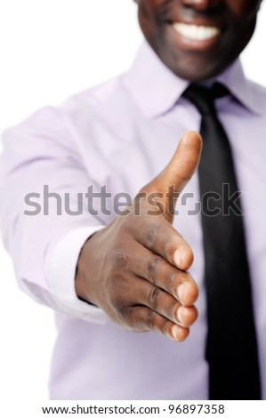 Black african businessman handshake to show business agreement - stock photo