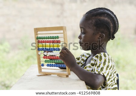 Black African Child Learning to Count as an Educational Symbol - stock photo