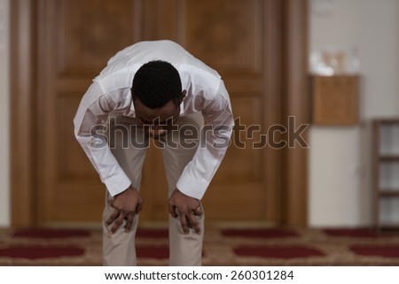 Black African Muslim Man Is Praying In The Mosque - stock photo