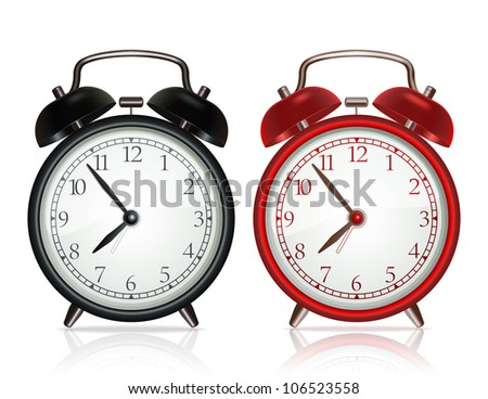 Black alarm clock and red alarm clock on white background
