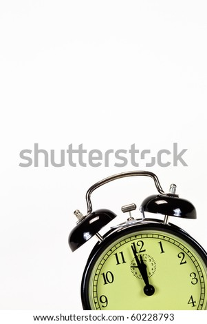 Black alarm clock isolated in bottom right corner