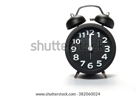 Black alarm clock  on white background - stock photo