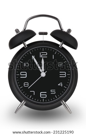 Black alarm clock with the hands at 5 minutes till 12. Illustrating Time is Running Out isolated on a white background - stock photo