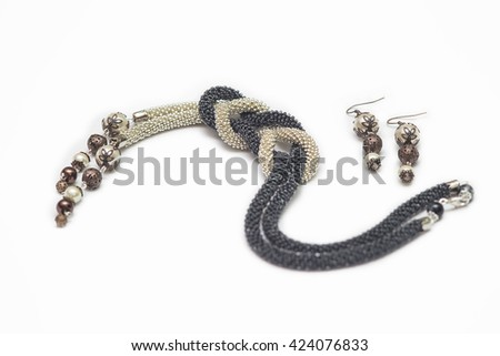Black and beige crocheted necklace with pendants