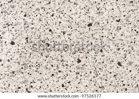 Black and beige stone background