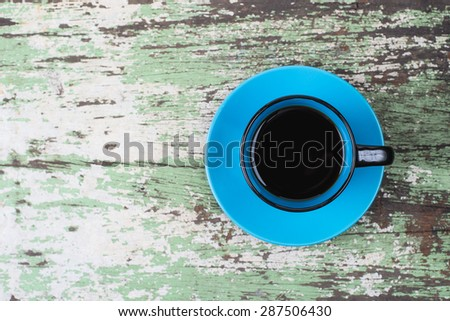 black and blue cup coffee on old wood table