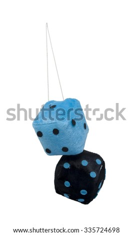 Black and Blue Fuzzy dice that are usually hung from the rear view mirror of a car - path included - stock photo