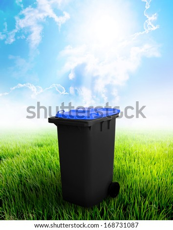 Black And Blue Recycle Bin Ecology Concept With Landscape Background.