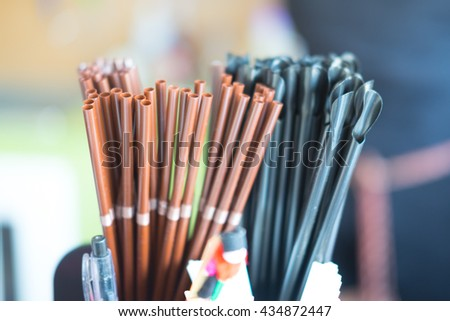 black and brown coffee straws close-up