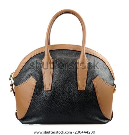 Black and brown female leather handbag isolated on white background.  - stock photo