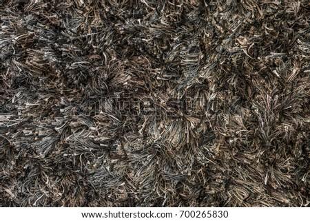 black and brown shag rug