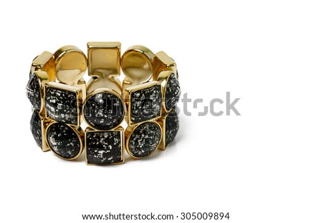 black and gold bracelet on white background. - stock photo