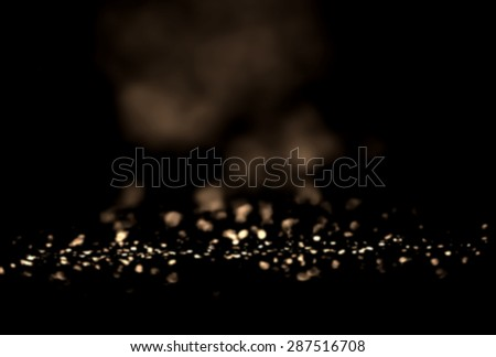 Black and Gold Festive Abstract background. Christmas twinkled bright background with bokeh defocused white and silver  lights. Magic texture  - stock photo