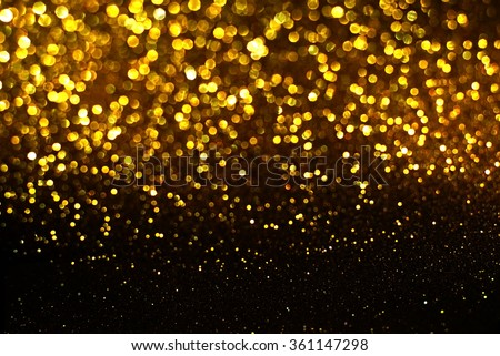 black and gold glitter bokeh texture abstract background - stock photo