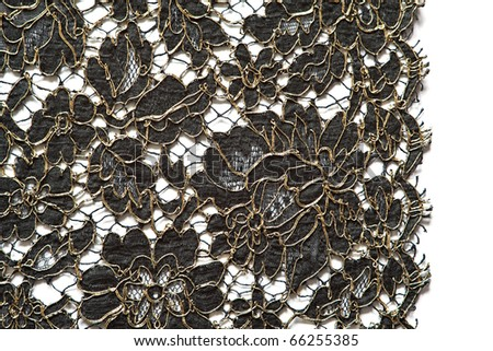 Black and gold lace on a white background. - stock photo