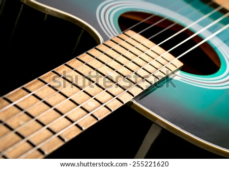 black and green acoustic guitar - stock photo