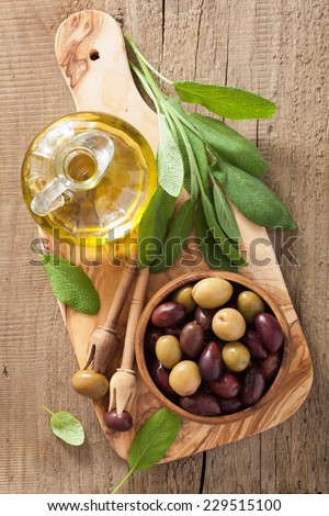 black and green marinated olives oil sage leaf  - stock photo
