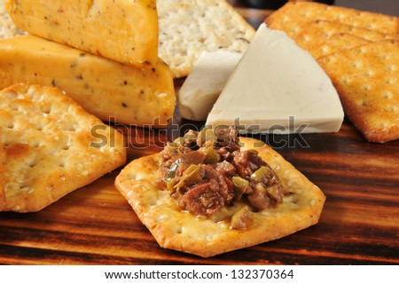Black and green olive bruschetta with crackers and pepper jack cheese - stock photo