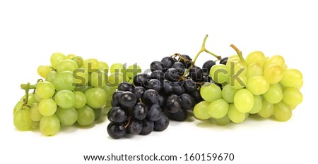 Black and green ripe grapes. Isolated on a white background.