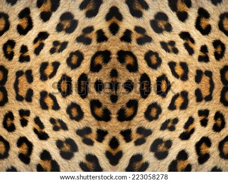 Black and orange kaleidoscope leopard fur pattern - stock photo