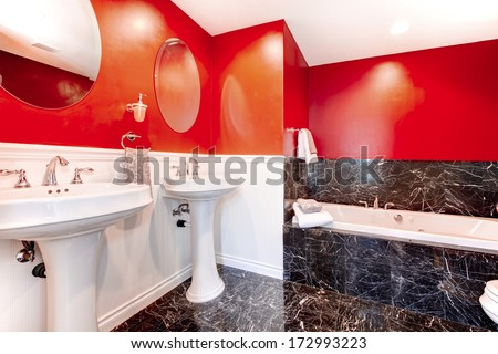 Black and red bathroom with concrete black floor