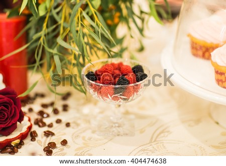 black and red berry shaped candies - stock photo