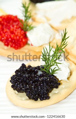 black and red caviar canape - stock photo