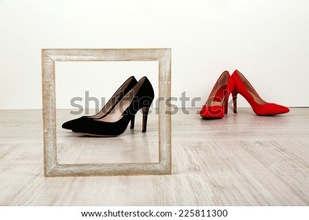 Black and red women shoes with frame on floor  - stock photo
